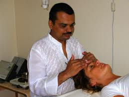 Dr Shah treating a patient